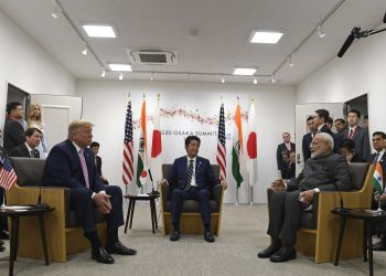 Japanese PM Shinzo Abe (c), US President Donald Trump (left) listen as Indian PM Narendra Modi speaks during the G20 summit in Osaka, Friday. Pic AP/PTI