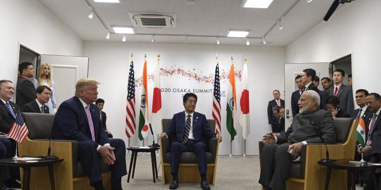 Japanese PM Shinzo Abe (c), US President Donald Trump (left) listen as Indian PM Narendra Modi speaks during the G20 summit in Osaka, Friday. Pic AP/PTI