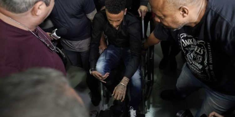 Neymar went to the station in an attempt to defend himself, sitting in a wheelchair after spraining his ankle the night before in a pre-Copa America friendly.