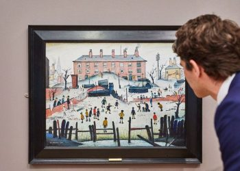 Painted in 1938, 'A Cricket Match' shows Lowry's artistic finesse at its best. He gives children the centre stage, both as enthusiastic players and spectators. (Image: Sotheby's)