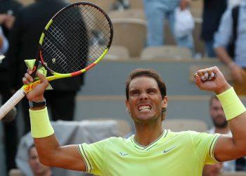 Rafa Nadal celebrates his victory over Roger Federer at Roland Garros, Friday