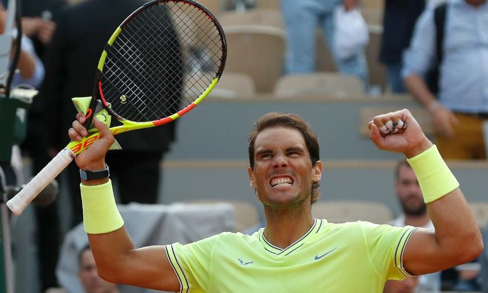 Rafa Nadal celebrates his victory over Roger Federer at Roland Garros, Friday