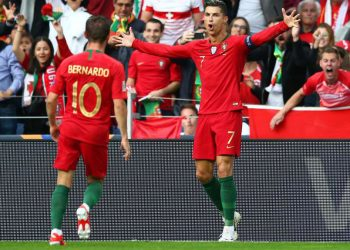 Cristiano Ronaldo (7) celebrates with a teammate after scoring a goal against Switzerland, Wednesday