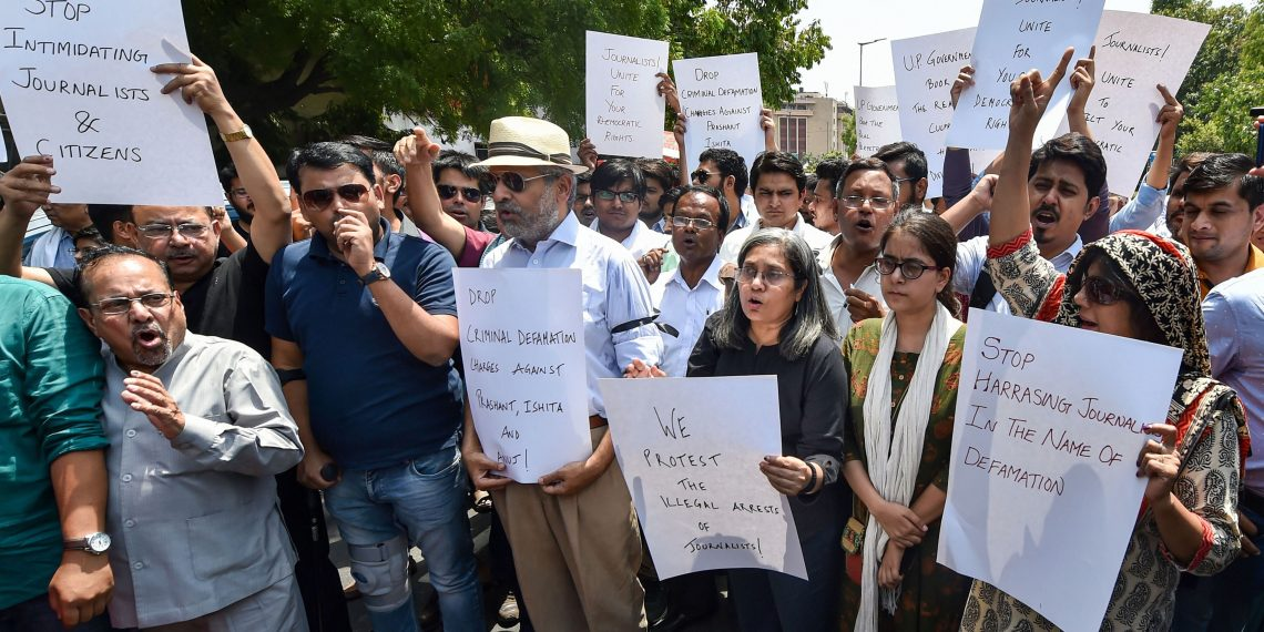 Jagisha Arora, wife of journalist Prashant Kanojia who was arrested by UP Police, along with other journalists stages a protest against Kanojia's arrest, at Press Club in New Delhi, Monday
