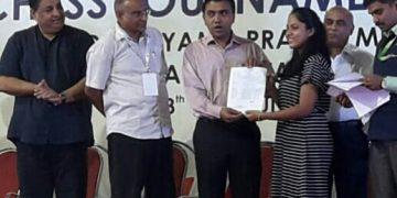 Saina Salonika receiving her International Master norm from Goa Chief Minister Pramod Sawant