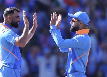 Mohammed Shami (L) celebrates with skipper Virat Kohli after dismissing a West Indian batsman, Thursday