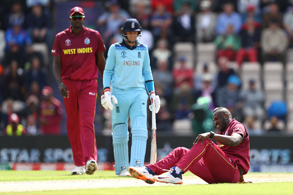SOUTHAMPTON, ENGLAND - JUNE 14: Andre Russell of West Indies lies on the wicket after injuring himself bowling during the Group Stage match of the ICC Cricket World Cup 2019 between England and West Indies at The Ageas Bowl on June 14, 2019 in Southampton, England. (Photo by Michael Steele/Getty Images)