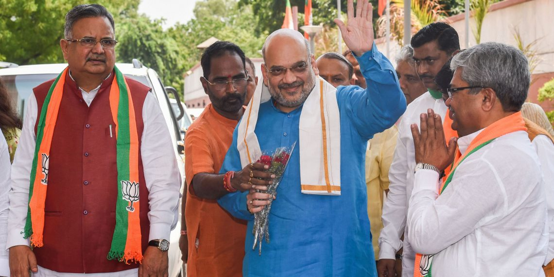 Union Home Minister and BJP president Amit Shah waves as he arrives for a meeting of BJP national office-bearers and state-heads, in New Delhi, Thursday