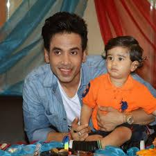Tusshar Kapoor with his son Laksshya Kapoor on his 1st birthday