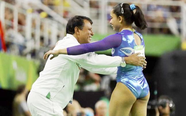 Dipa Karmakar with coach Bisweswar Nandi. File pic