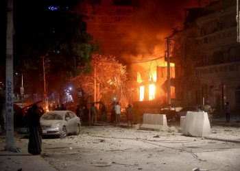 A suicide bomber rammed a vehicle loaded with explosives into the Medina hotel in the port town of Kismayo Friday before several heavily armed gunmen forced their way inside, shooting as they went, authorities said.
