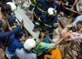 A child being brought out from under the debris by rescue personnel at the site of the Dongri building collapse