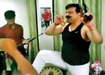 Pranav Singh Champion with a gun in his hand