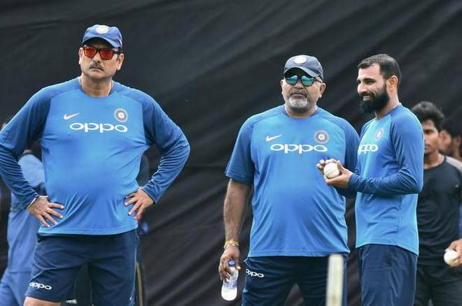 (From left) Head coach Ravi Shastri, bowling coach Bharat Arun and Mohammed Shami who should have played against New Zealand