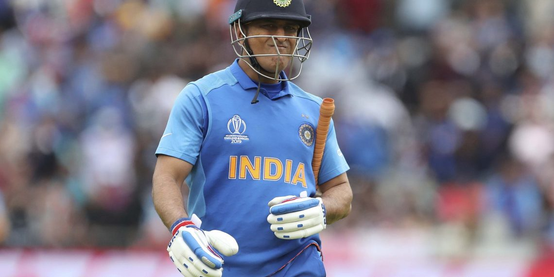 MS Dhoni reacts while leaving the ground after his dismissal in the game against New Zealand
