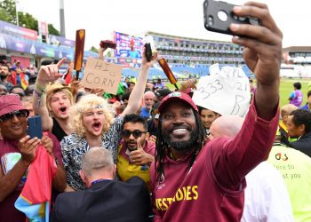 Chris Gayle takes a selfie with fans after the game Thursday