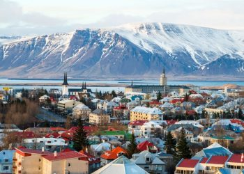 A small population of 355,000 coupled with a high dependence on imported goods and high taxes on alcohol all help explain Iceland's steep prices.