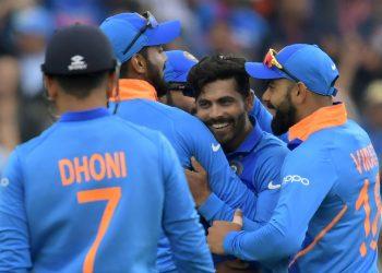Teammates celebrate with Ravindra Jadeja after the dismissal of Henry Nicholls