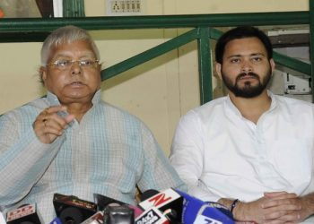 Lalu Prasad Yadav (L) and son Tejashwi. File pic
