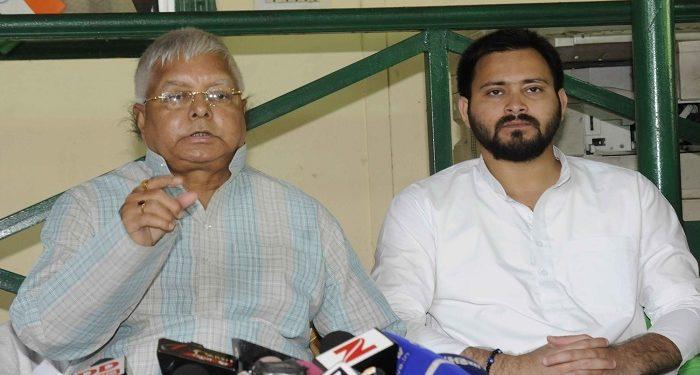 Lalu Prasad Yadav (L) and son Tejashwi. File pic