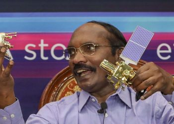 ISRO chairman K Sivan displays the Orbiter and the Rover in Bangalore, Tuesday