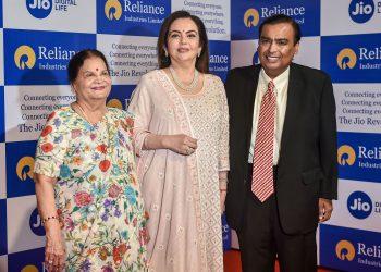 Mukesh Ambani (R), along with his wife Nita Ambani (C) and mother Kokilaben Ambani