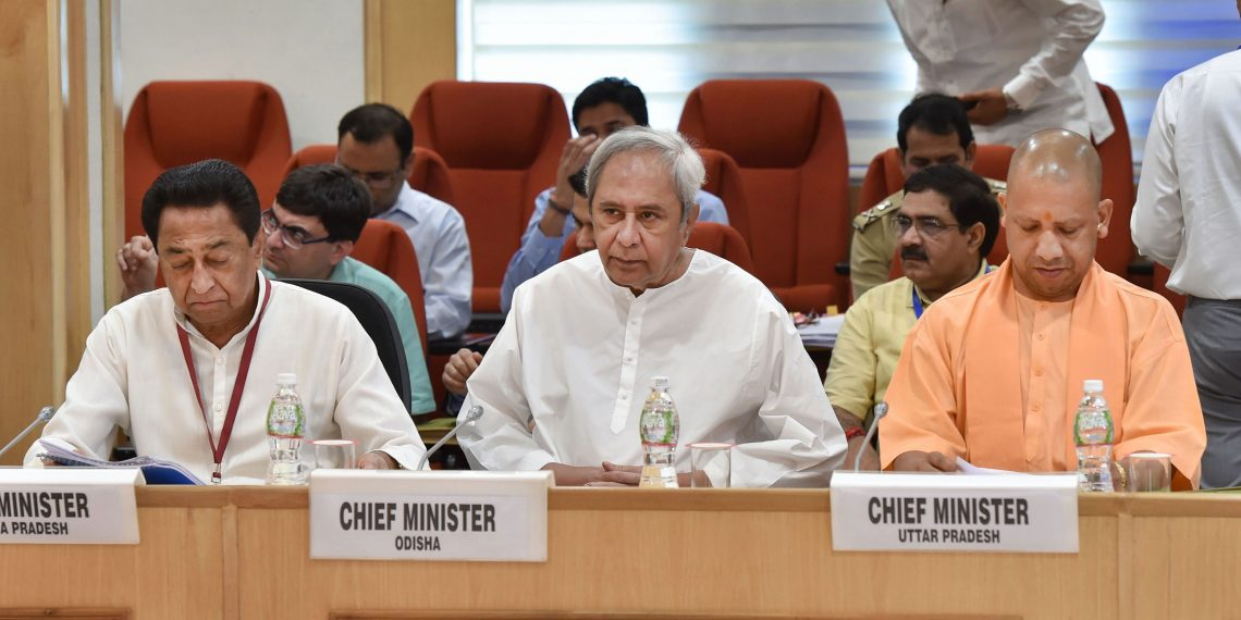 Odisha Chief Minister Naveen Patnaik along with MP CM Kamal Nath (L) and UP Chief Minister Yogi Adityanath during the meeting, Monday at New Delhi
