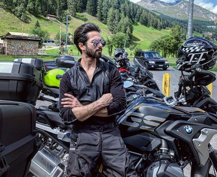 The 'Kabir Singh' star shared a photograph of himself, leaning on his bike and with a picturesque countryside backdrop.