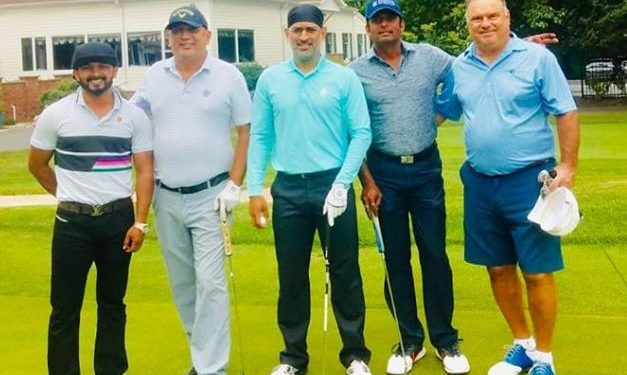 Sporting his new bandana look Dhoni was seen flaunting his salt and pepper look with a club in hand alongside Jadhav on the latter's Instagram post.