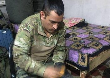 A picture of MS Dhoni polishing army boots goes viral