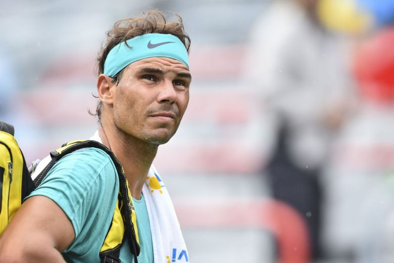 Top-seeded holder Nadal suffered through a two-hour rain interruption before dismissing Britain's Daniel Evans 7-6 (8/6), 6-4 Wednesday.