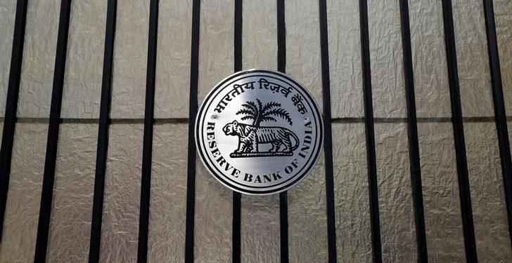 FILE PHOTO: A Reserve Bank of India (RBI) logo is seen at the entrance gate of its headquarters in Mumbai, India June 7, 2017. REUTERS/Shailesh Andrade/File Photo