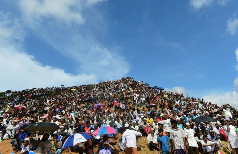 Under the scorching sun, thousands joined in a popular song with the lyrics 'the world does not listen to the woes of Rohingya'.