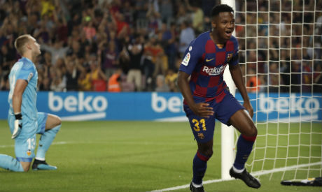 Barcelona's Ansu Fati, right, celebrates after scoring the opening goal as Valencia's goalkeeper Jasper Cillessen reacts during the Spanish La Liga soccer match between FC Barcelona and Valencia CF (AP)