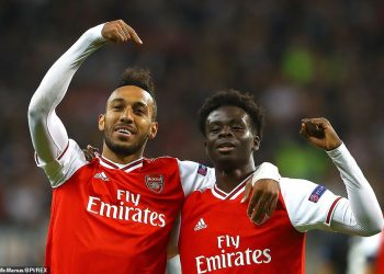 Two of the goal scorers for Arsenal Pierre-Emerick Aubameyang (L) and Bukayo Saka