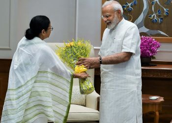 West Bengal Chief Minister Mamata Banerjee presenting a flower bouquet to Prime Minister Narendra Modi ahead of their meeting Wednesday