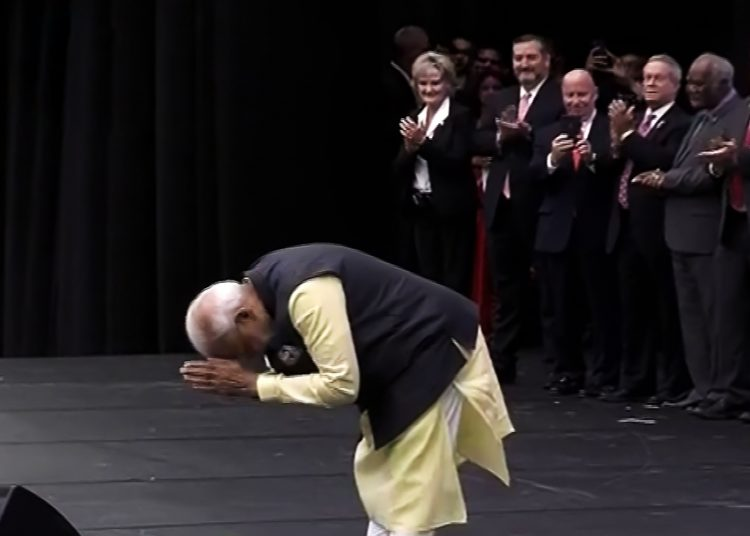 Prime Minister Narendra Modi greets his supporters as he arrives for the mega 'Howdy, Modi' gala event in Houston, Sunday. PTI Photo