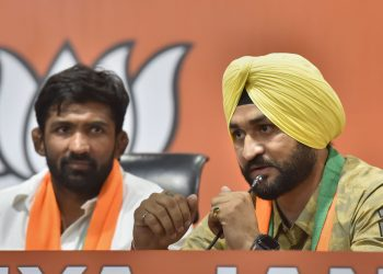 Former Indian hockey team captain Sandeep Singh and Olympic medallist wrestler Yogeshwar Dutt talks to the media after joining the BJP, Thursday