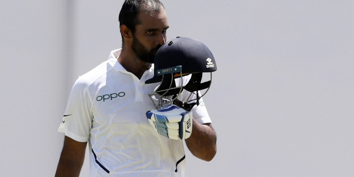 Hanuma Vihari kisses the Tricolour on his helmet after getting his first Test hundred against the West Indies