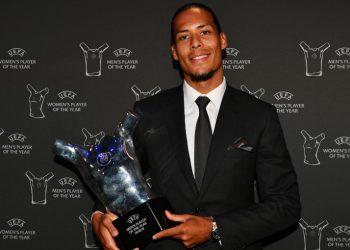 Virgil van Dijk with the UEFA Best Men's Player trophy