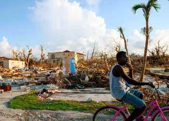 They search amid alarming reports that 1,300 people remain listed as missing nearly two weeks after Hurricane Dorian hit the northern Bahamas.