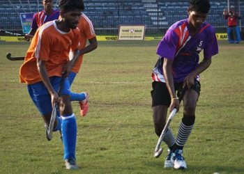 Players vie for the ball during the Sports Hostel versus Ganjam game
