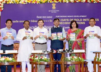 Dignitaries including Union Minister of State for Shipping, Chemicals and Fertilisers Mansukh Mandaviya (fourth from right) and Bhubaneswar MP Aparajita Sarangi releasing a book at Hotel Mayfair in City