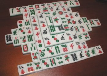 Mahjong is a tile-based game that was developed in China during the Qing dynasty and has spread throughout the world since the early 20th century.