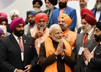 The community members met Modi Saturday in Houston and presented him with a traditional Siropa (long scarf).