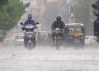 At least three persons, including a woman, died after being swept away in flooded rivulets and nullahs at different places of Ganjam district, police said.