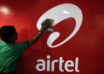 A worker cleans a Bharti Airtel logo inside its shop in Kolkata February 2, 2011.REUTERS/Rupak De Chowdhuri/File Photo