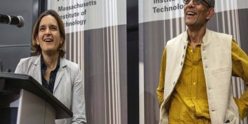 Esther Duflo (L) and Abhijit Banerjee speak during a news conference at Massachusetts Institute of Technology, Monday