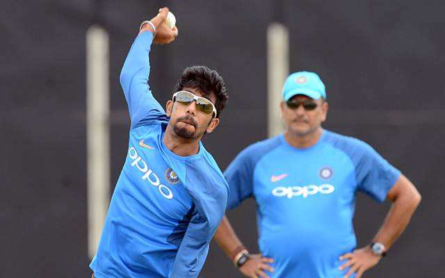 Indian cricketer Yuzvendra Chahal (L) delivers a ball as coach Ravi Shastri looks on during a practice session at the Rangiri Dambulla International Cricket Stadium in Dambulla on August 18, 2017.  The one day international cricket series between India and Sri Lanka starts in Dambulla on August 20. / AFP PHOTO / LAKRUWAN WANNIARACHCHI        (Photo credit should read LAKRUWAN WANNIARACHCHI/AFP/Getty Images)