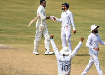 It's all over: Virat Kohli shakes Kagiso Rabada's hand at the end of the game, Sunday